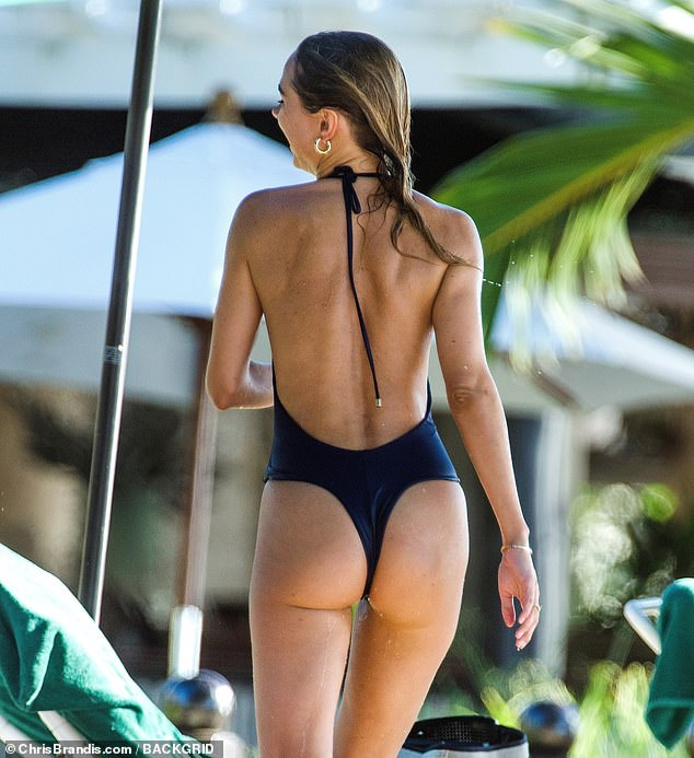Pert: The intricate design featured a plunging front, was backless and had a thong style to it, displaying Kimberley's supple behind