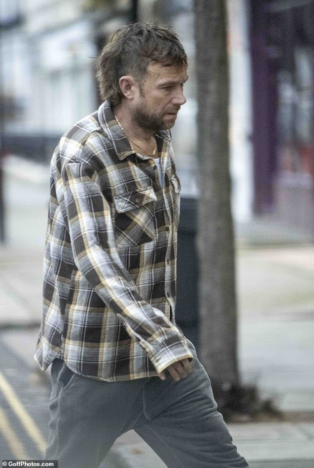 It's a mullet: Blur frontman and Gorillaz star Damon Albarn debuted an edgy new hairstyle as he stepped out to grab a coffee in London recently