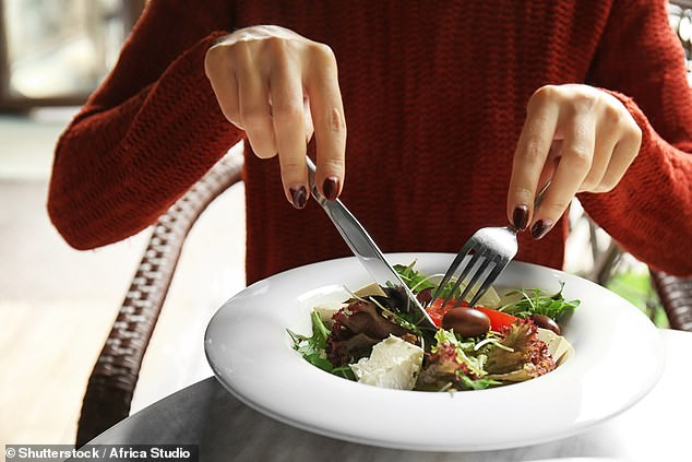 A British woman has sparked a heated debate about the importance of table manners, after revealing she holds her cutlery unconventionally (file image)