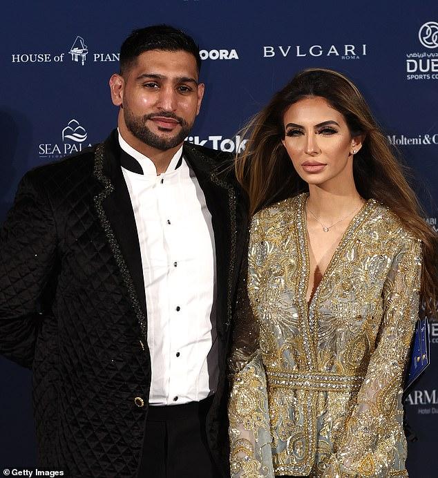Glam:Faryal Makhdoom cut a glam figure as she posed alongside her husband Amir Khan at the Dubai Globe Soccer Awards at the Armani Hotel on Sunday