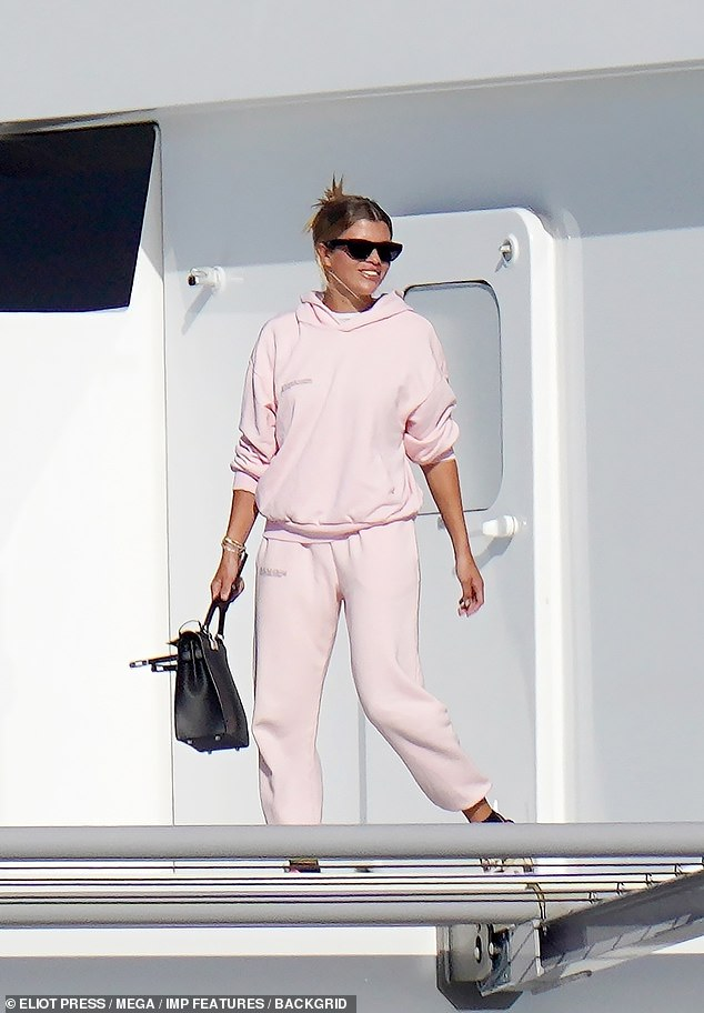 Off she goes:Sofia Richie appeared in great spirits as she prepared to jet out of the Caribbean island on Saturday