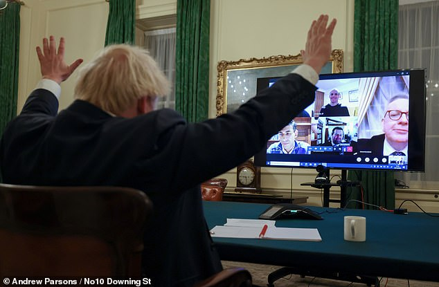 The government has allocated one day of discussions about the Brexit deal for the House of Commons and Lords. Pictured: Boris Johnson in his office in Number 10 briefing members of the Cabinet on the news of a possible Brexit deal on December 23