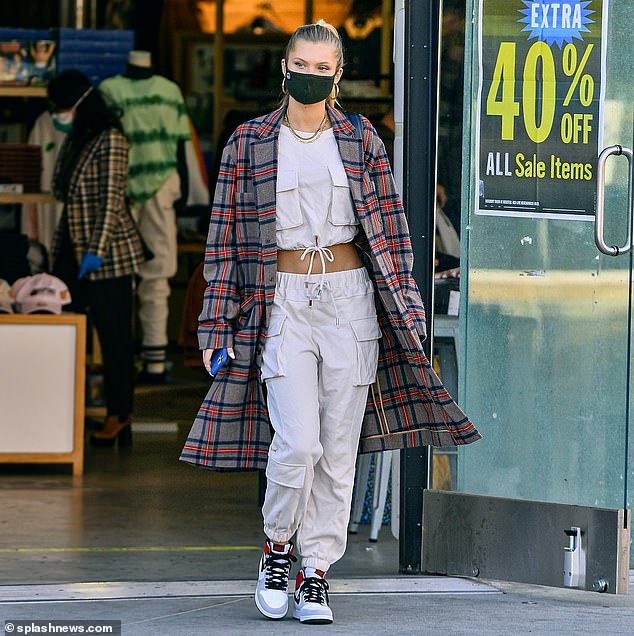 Air of cool: Josie Canseco, 24, rocks a Gucci flannel coat and a cropped tracksuit as she flashes her abs while shopping on Melrose