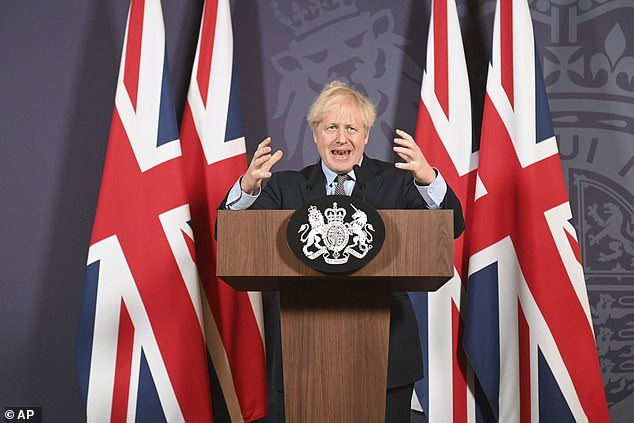 Boris Johnson speaks during a media briefing in Downing Street, London, December 24