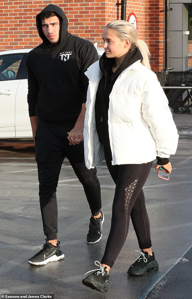 Afternoon stroll: The 2019 Love Island runner-ups, both 21, wrapped up warm from the winter chill after enjoying an intimate Christmas together amid the Covid-19 pandemic