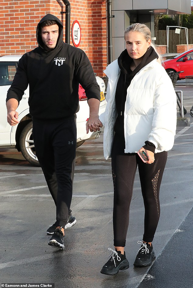 Loved-up: Molly-Mae Hague and Tommy Fury appeared to be as smitten as ever as they stepped out for a stroll around Hale Barns, Cheshire, on Sunday afternoon