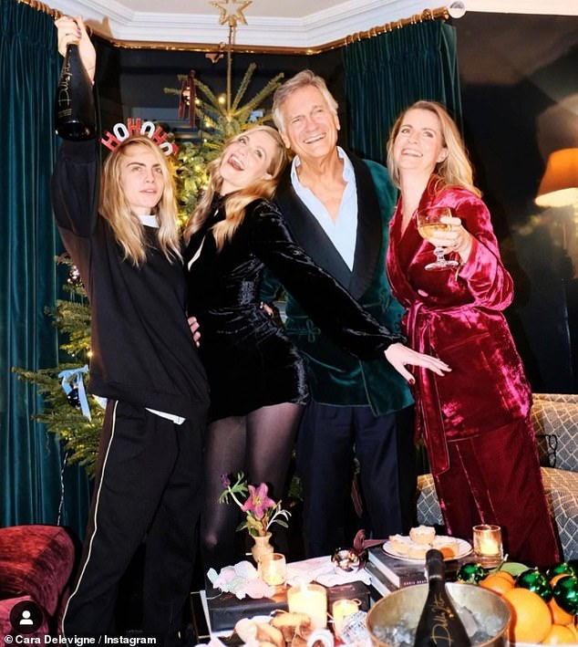 Family: Cara Delevingne enjoyed some quality time with her sisters Poppy, 34, (centre left) Chloe,35, (far right) and father Charles, 71, over the Christmas period