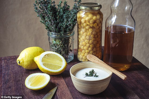 Using safe, natural products, such as lemon and vinegar, will ensure you don't harm the kitchen in any way while also killing germs