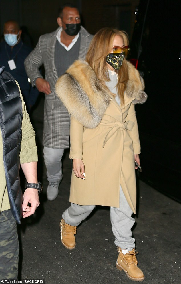 Jennifer Lopez bundles up in a fur-trimmed coat in chilly NYC after spending Christmas in Miami