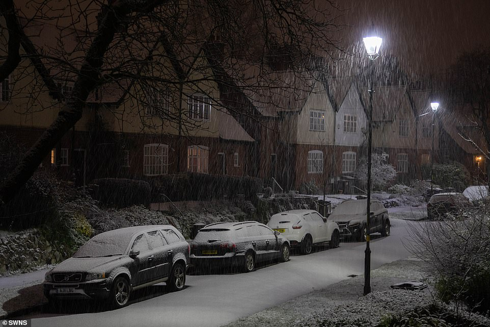 Parts of the UK were already blanketed on Sunday after Bella battered regions overnight on Boxing Day. More snow fell overnight, including in Birmingham (pictured)