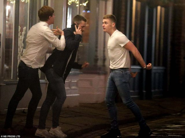 Outdoors, you can meet family and friends who you do not live with in groups no larger than six. Pictured: Men scrapping in York last night