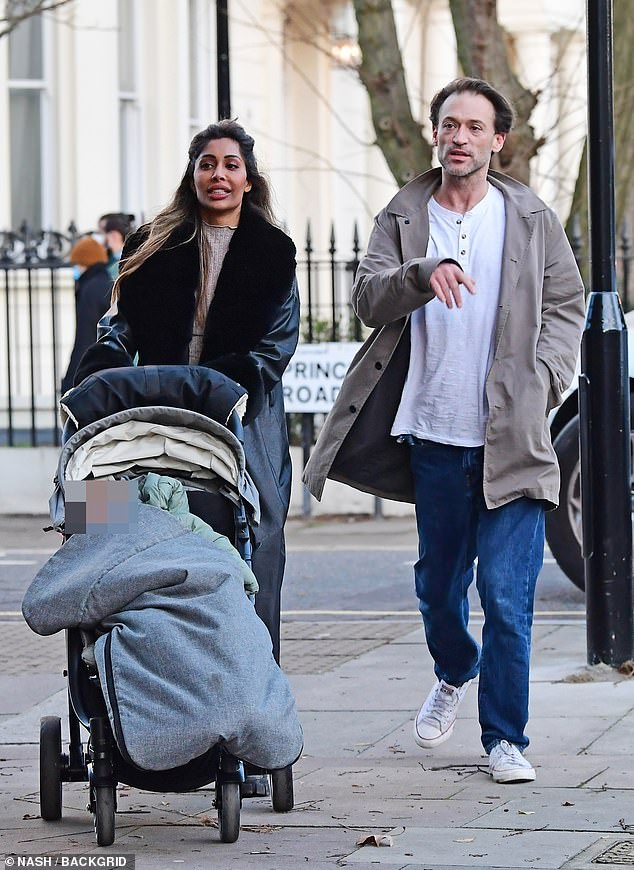 Ex-EastEnders hunk Paul Nicholls enjoys stroll with a female pal and her baby