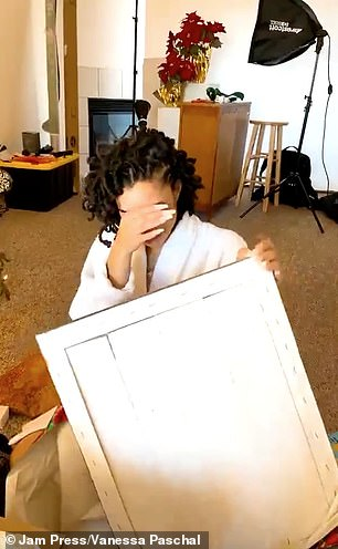 Pictured, Vanessa tearing up after unwrapping the painting