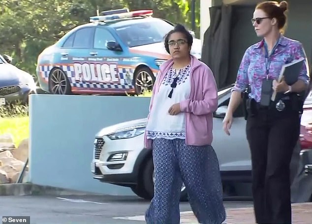 Dr Neupane is pictured leaving Morningside Police Station on Sunday. She is believed to have put the baby to bed the night before her body was found in the cot