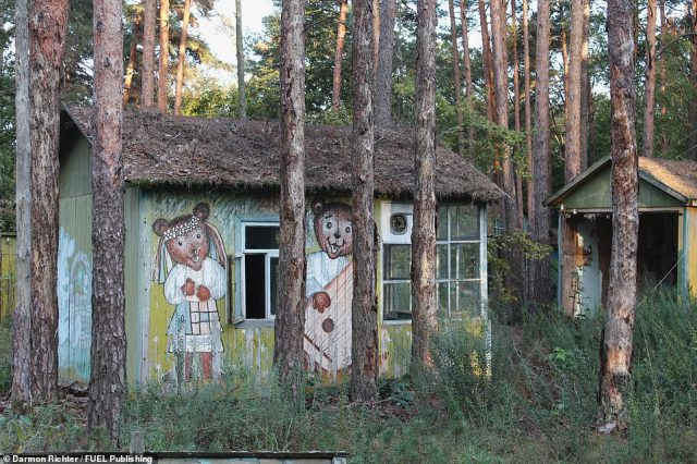 The Izumrudniy ('Emerald') Holiday Camp, near Chernobyl: Once a popular spot for summer holiday breaks, these rustic wooden chalets, painted with characters from cartoons and fairy tales, were completely destroyed by forest fires in April 2020