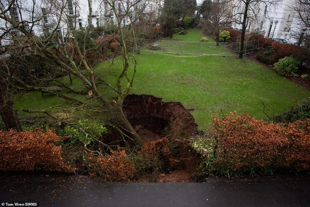 The 40ft sinkhole swallowed an entire tree and parts of the road after opening up in Canynge Square in Clifton, Bristol, on December 25