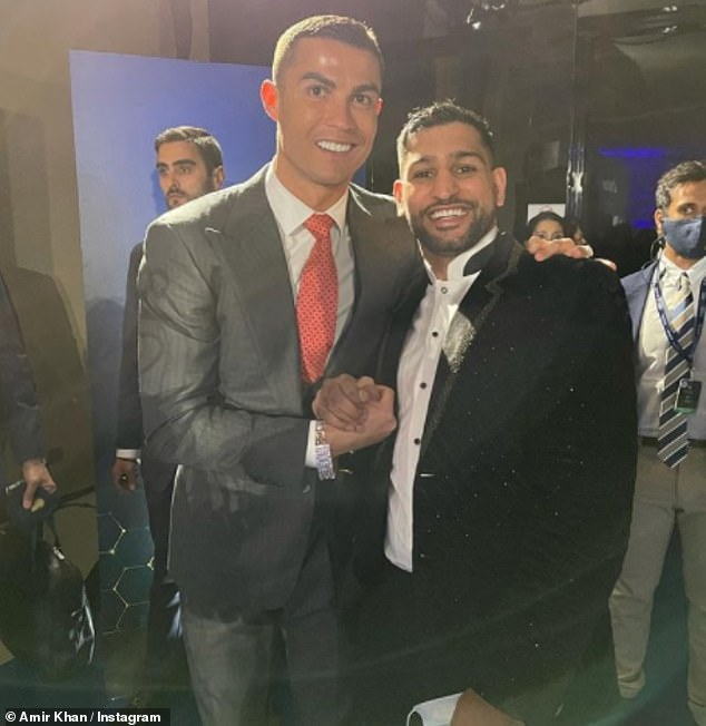 Event: Instead of adhering to rules for those who come into contact with anyone testing positive, Khan jetted off to Dubai where he warmly embraced Cristiano Ronaldo at an awards ceremony on Sunday