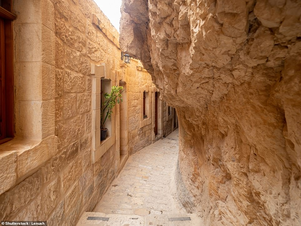 Hermits and monks have lived on the Mount of Temptation in natural caves since the early centuries of Christianity. This is an alley at the monastery there