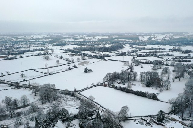Snow-covered fields near the village of Oulton in Staffordshire yesterday which turned into a winter wonderland
