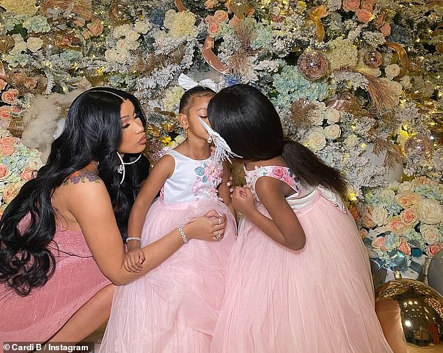 Family time: The WAP hitmaker rang in Christmas surrounded by her family as Kulture opened presents in a sparkly dress