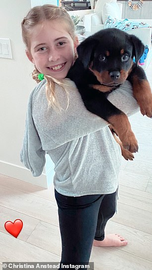 Child approved: She posted an adorable photo to her Instagram Story of daughter Taylor, 10, holding their new fur baby