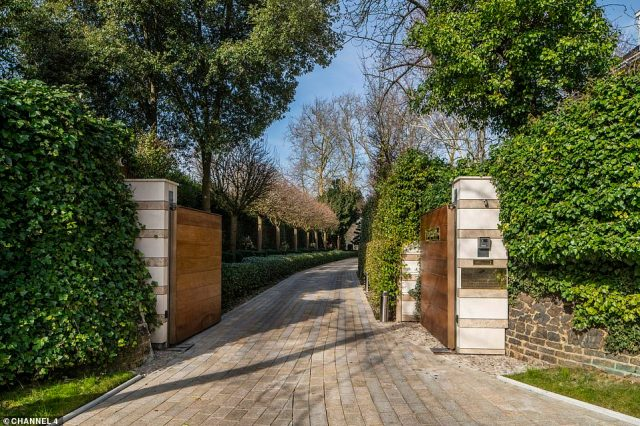 The expensive property, which is situated in one of London's most exclusive suburbs, comes with a gate at the front and a lengthy driveway