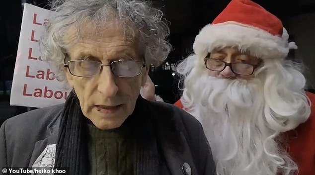 Piers Corbyn (left) reads out a letter he is delivering to Jeremy which addresses his suspension from the Labour Party over his response to the party's anti-Semitism report earlier this year