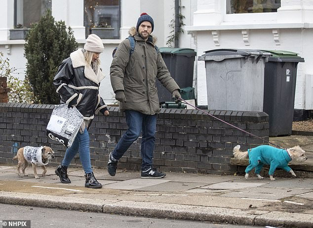 Family outing: The couple appeared in good spirits during their stroll with their two beloved pet pooches Baxter and Shirley