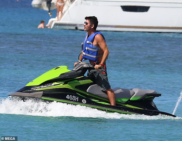 Focus: Simon took a moment to take in his scenic surroundings aboard the jet ski