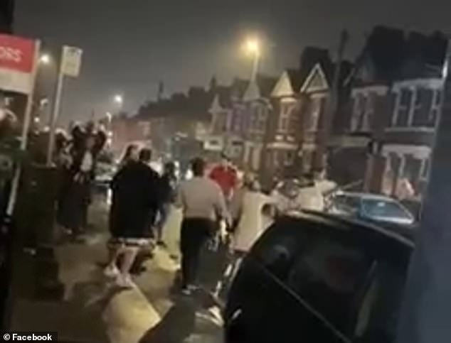 Shocking footage shows a 'Wild West'-style brawl in the middle of a residential street in Luton, Bedfordshire last night