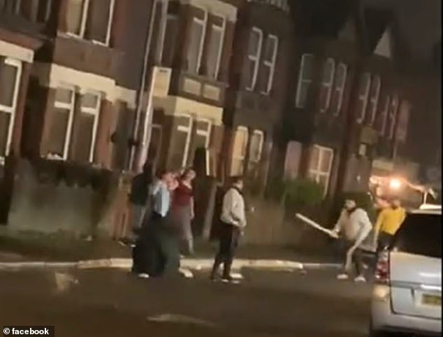 Combatants were seen fighting each other outside a supermarket on a residential street with a variety of weapons, as onlookers watched in horror