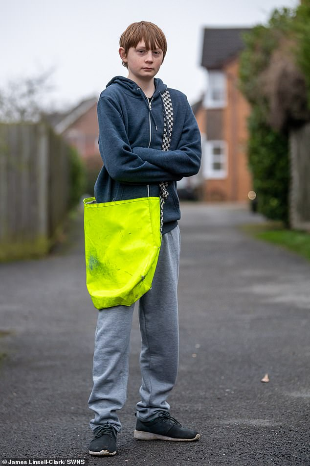 John Latimer, 43, said he is considering suing Sutherland Way Stores in Stamford, Lincolnshire, for unfair dismissal after his son Keenan (pictured) lost his job 'just for following Government guidelines'