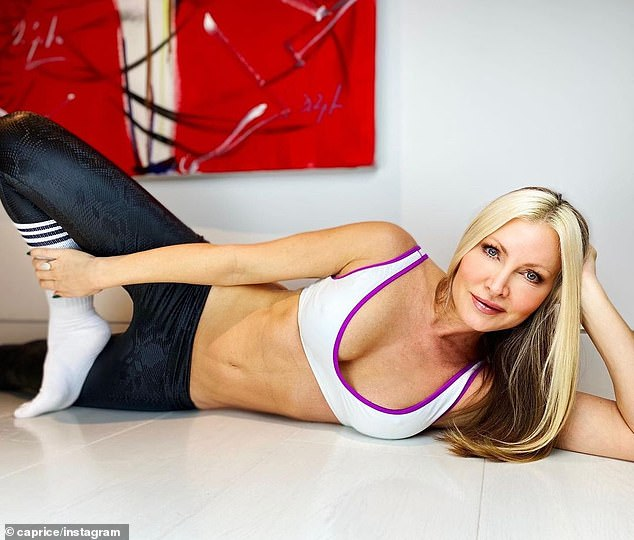 Sensational: The model, 49, looked sensational as she posed up a storm in a white sports bra, which she teamed with blue leggings and white Adidas socks