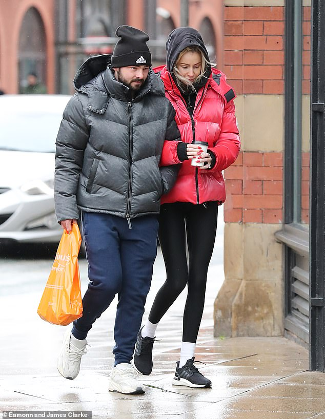 Outing:Olivia Attwood and fiancé Bradley Dack bundled up as they stepped out to do the food shop in Manchester on Tuesday