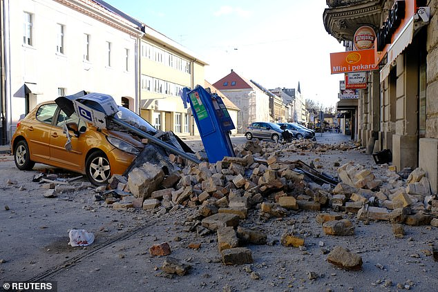 A destroyed car is seen on a street after an earthquake in Sisak, Croatia on December 29