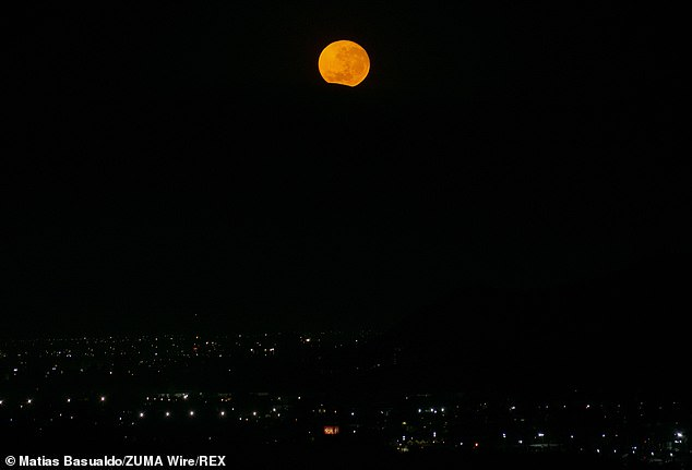 The moon will be in the sky for more than 15 hours from Tuesday evening into Wednesday morning, making it the longest full moon of the year. The moon setting behind a hill on the morning of December 29 in Chile