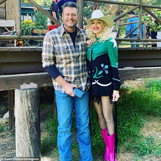 I'm a little bit country: Gwen was decked out in Western girl as she cosied up to her honey