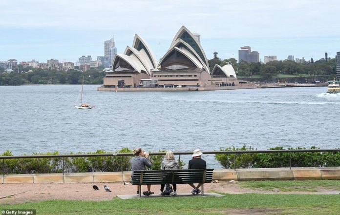 Sydney's uptick in coronavirus cases has sparked fresh calls for a brutal city-wide lockdown similar to Melbourne's - but the experts are divided. Pictured: The Opera House on Wednesday