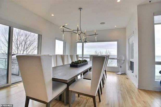 Views: The dining room table is situated on a balcony, offering spectacular coast views.