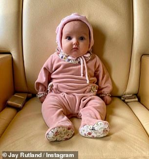 Lovely: The father-of-two also posted an adorable photo of baby Serena in a pink floral outfit