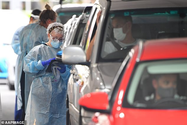 Healthcare workers are seen driving through the testing facility at the Springers Leisure Center in Cheltenham, Melbourne on Thursday, December 31