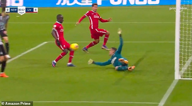 Liverpool seem certain to score but Darlow manages to push the ball against Mane's knee