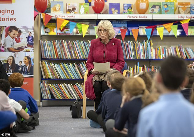 Camilla, pictured in January last year, at a library where she read to a group of school children as part of her work as a patron of the National Literacy Trust
