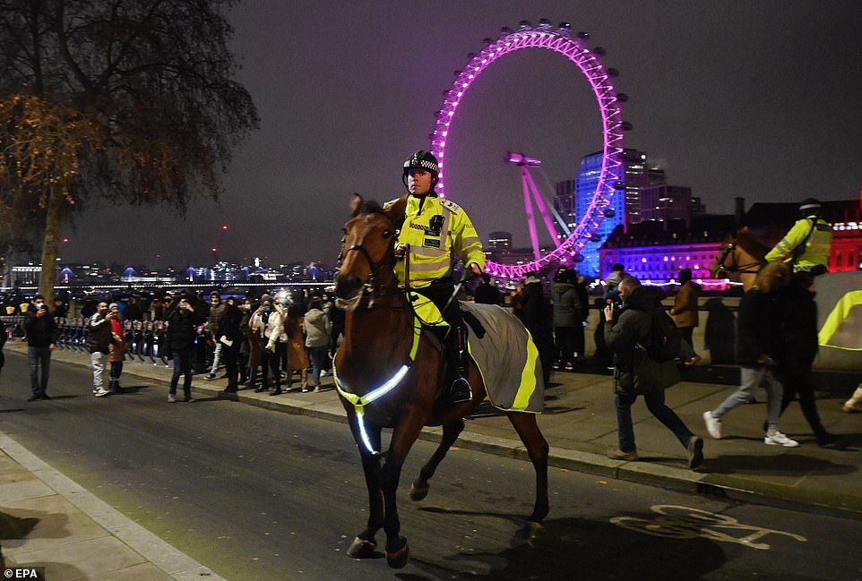Met Police officers on horseback were dispatched on the banks of the River Thames in order to disperse crowds from London