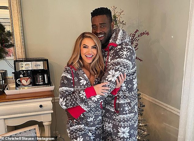 Holiday cheer: Stause and Motsepe met on set of the hit show DWTS and stepped out together on December 2 after she fended off rumors she was dating her dance pro Savchenko who split from his wife shortly after the show; pictured December 25
