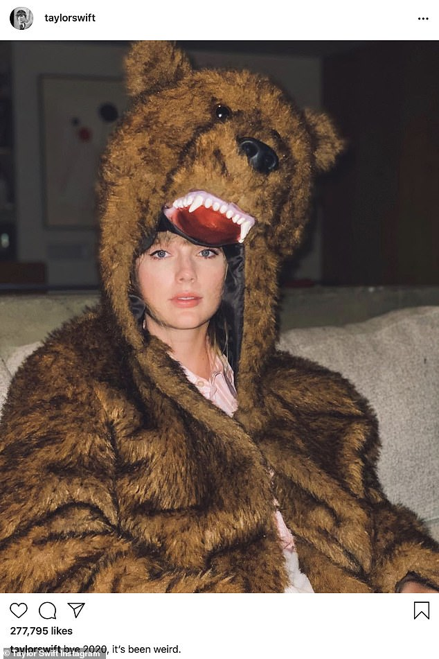 'It's been weird': Taylor's own NYE photo showed her in a bear costume, which some fans speculated was an homage to the horror film Midsommar