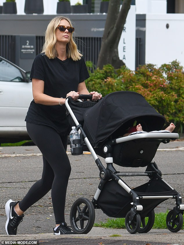 Pregnant Sylvia Jeffreys covers up her baby bump on walk with son Oscar, 10 months, in Sydney