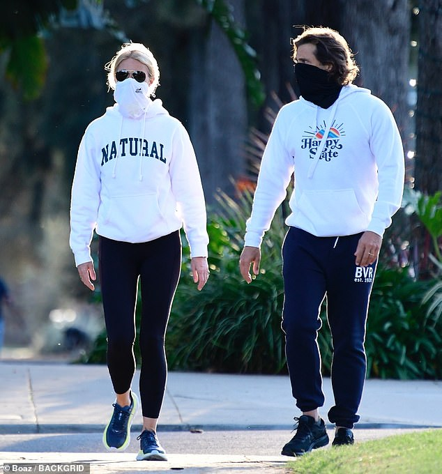 Low key:Brad was similarly dressed with a white graphic hoodie, navy sweatpants and black Asics trainers