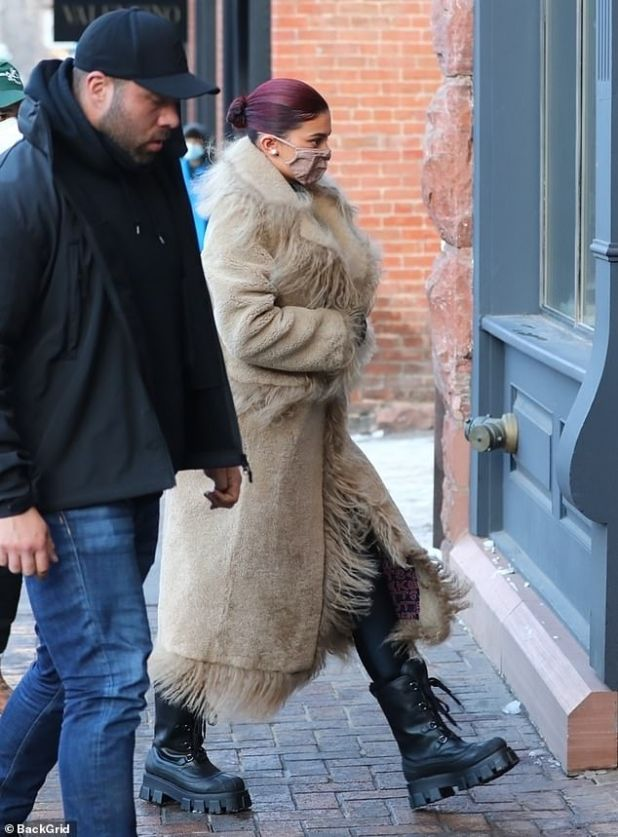 Cozy: Her coat hems and pockets were adorned with long fur strands for extra warmth