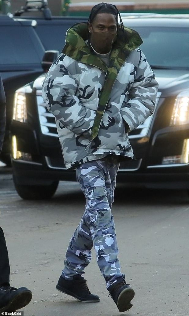 Chemo Chick: Travis Scott was also present, bundled up in a gray camflage ski suit